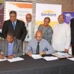 CEO of Santam, Mr John Lomberg (front left) and Eden Municipal Manager, Mr Godfrey Louw, signs the Service Level Agreement with (fltr back) Eden's Portfolio Councillor, John Maxim, Executive Mayor, Wessie van der Westhuizen, Executive Deputy Mayor, Councillor Lionel Esau, Portfolio Councillors, Sharon May and Henry McCombi, as well as Eden's Executive Manager: Management Services, Mr Clive Africa, at the back.