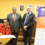 Fltr: Bitou Executive Mayor, Cllr Memory Booysen, Knysna Executive Mayor, Georlene Wolmarans (sitting), Eden Executive Mayor, Cllr Wessie Van der Westhuizen and Mr Drikus Jacobs, Managing Director of Aurecon (George office) busy signing the service level agreement at the launch.