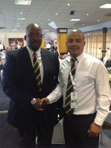 Rudy Claassen, President of the SWD Cricket Board (right) is congratulated by Mr Chris Nenzani, newly elected President of CSA, as the 12th full affiliate of CSA.