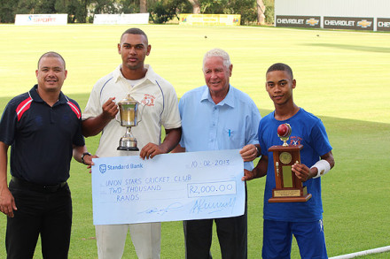 Anver Venter (2nd from left), captain of Union Stars B, who won the SWD Reserve League competition receives the trophy from Rudi Claassen (left), President of the SWDCB. On the right is Esjone Goliath (captain of the C-team) with Mr Simon Swigelaar (Honorary Life President SWDCB)