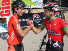 South African Renay Groustra (left) congratulates German partner Daniel Gathof after winning the three-day Rocky Mountain Garden Route 300 mountain bike race which finished in Knysna on Sunday. Photo: Coetzee Gouws/fullstop