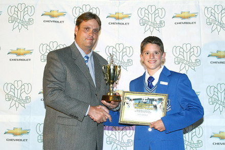Travis Ackerman received the Award as Primary Schools Player of the Season from Mr Danie Ooshuizen member of the SWD Schools Cricket Committee.