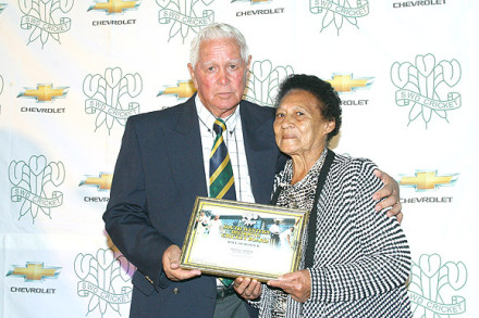 Ms Waveny Carelse, widow of the late Percy Carelse (a former SWD player) who recently passed away, received a Roll-of-Honour Award from Mr Simon Swigelaar, Honorary-Life President SWD Cricket Board