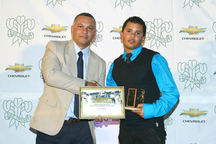 Lance Roelfse received the Trophy as Bowler of the Season in the Coca Cola SWD U/19 Schools competition from Rickey Bell, Executive Committee member SWDCB