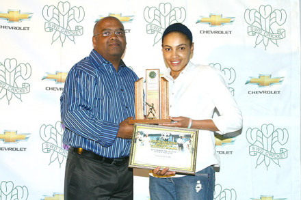 Marnizell Rabie, bowler of the season in the SWD Women's league received the trophy From Llewllyn Louw, SWDCB Executive Committee member
