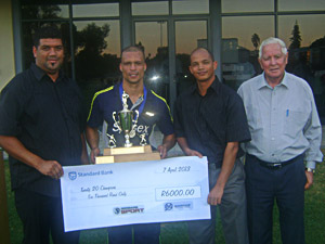 Erinn Ewerts, captain of Sussex (2nd from left) received the trophy and prize money as Winners of the SWDCB Twenty20 competition from Angus Roelfse (left) the SWDCB Executive Committee member for Local Leagues. On the right are Shael Laminie (SWDCB Executive Committee member: Finances) and Simon Swigelaar (Honorary Life-President of the SWDCB).