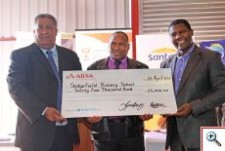 Executive Mayor, Councillor Wessie van der Westhuizen (left) and CEO of Santam, Mr John Lomberg (right) hand over a cheque to the value of R25 000 to the school principal of Sedgefield Primary School, Mr Stephanus Dogh.  Executive Mayor, Councillor Wessie van der Westhuizen (left) and CEO of Santam, Mr John Lomberg (right) hand over a cheque to the value of R25 000 to deputy principal of Pacaltsdorp High,  Mr Lorentuis Muller, who receives it on behalf of the school.