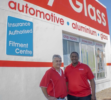 Gary Stieger (left), the managing member of new national automotive glass network My Glass, stands outside the founding branch in Port Elizabeth with network partner Mahlubi Sipamla. The company aims to tackle the monopoly which a couple of companies have on the industry.