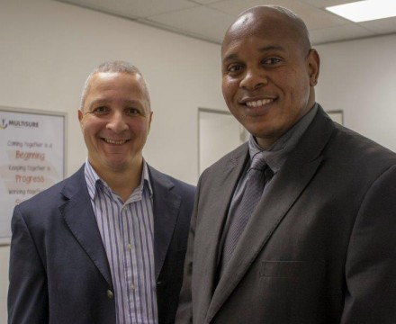 GROWING DEMAND . . . Multisure Corporation CEO Denton Goodford (left) and the company's Eastern Cape business advisor Vuyo Sityebi are kept busy by the people signing up for networking marketing to boost their salaries amid rising living costs.