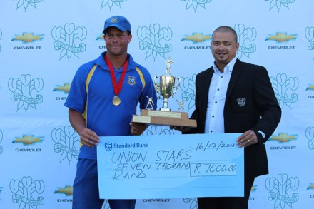 Pieter Stuurman, captain of Union Stars, receives the trophy from SWDCB President Rudy Claasen