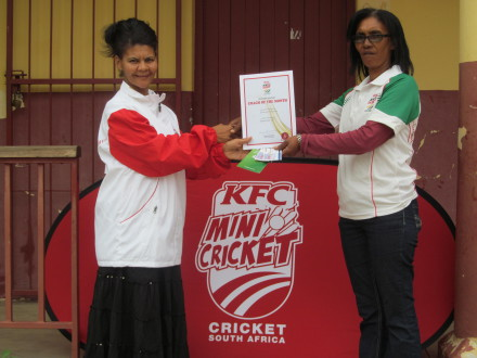 Ellouise Johannes (right) from Zoar EK Primary) was the SWD Cricket Board KFC Mini Cricket coach for the month of December 2014.  She received the award from Ms Meryl Daniels.