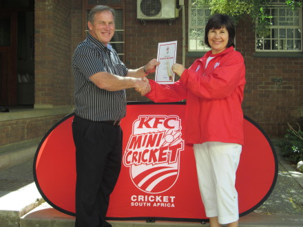 Michelle Baird (Van Reede Primary School) was the SWD Cricket Board KFC Mini Cricket coach for the month of November 2014.  She received the award from Mr Johnny Bischoff (Head Master).