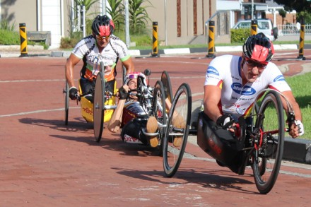 Competition was fierce amongst the leaders in the 2014 Outeniqua Wheelchair Challenge (OCC) on Saturday in George – vying for the top spot in the hand cycle division of the men's open paraplegic 42.2km marathon are Ernst van Dyk, Stuart McCreadie and Andries Scheepers. [Photo:  Elaine Swanepoel]