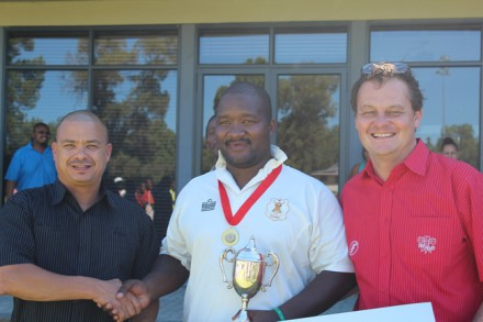 Deswill Claassen (center), captain of Blanco who won the SWDCB Promotion league competition after defeating Thembalethu by 9 wickets, received the trophy from Mr Rudy Claassen (left), President of the SWD Cricket Board.  On the right is Albertus Kennedy (CEO SWD Cricket).