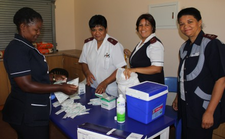 From left: Rachel De Boer,  Sister Charmaine Adams, Sister Brenda Potts  and Sister Susan Kruger are preparing their station to vaccinate the Grade 4 girls at M.M Mateza Primary School in Thembalethu, George.