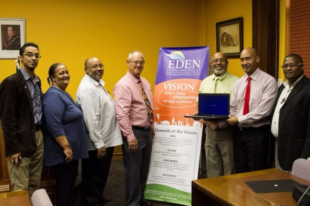 Eden District Municipality's Municipal Manager, Mr Godfrey Louw (2nd from right), hand the laptops over to the Mayoral Committee members (fltr): Councillors Tertuis Simmers, Sharon May, Henry McCombi, Johan Du Toit, Lionel Esau (Executive Deputy Mayor) and Cllr Johan Maxim.