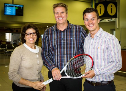 Lynette is seen handing the signed racquetto Greyvensteins' Cor van Deventer (middle) and Rohan Greyvenstein Jnr recently.