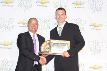Ross McMillan, received the Standard Bank Trophy, as player of the Season from Mr Rudy Claassen (President SWD Cricket Board)