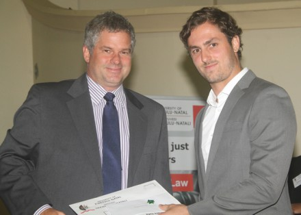 Howard Stephenson, a Director in Garlicke & Bousfield's Commercial Department, congratulates Caleb Jones, UKZN student on his Garlicke & Bousfield Top Environmental Law Student Award for 2013.
