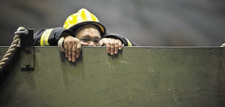 TOUGH AS NAILS: A firefighter goes through his paces during the gruelling two-day competition in George at the weekend. Organisers said the public needed to be exposed to what these life and property savers do   Image by: HALDEN KROG