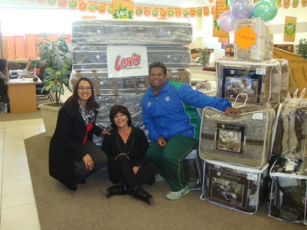 Ms Anneline George (an educator at Kretzenhoop Primary School)  and André du Plessis (right), SWD Academy Manager and High Performance Coach received furniture (beds and mattresses) as donated by Lewis Stores in George from Ms Joyce Venter, manager of Lewis Stores in George.