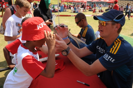 1.Chris Morris and Alviro Petersen signing autographs after getting active at the KFC Mini-Cricket Kids vs Proteas season launch.
