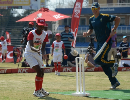 4.Kgomotso Rapoo, the captain of the KFC Mini-Cricket kids team, tries to run out Chris Morris in the KFC Mini-Cricket Kids vs Proteas launch.
