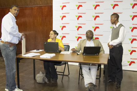 Mr Lester Jansen, business owner of Construction African Civil Project (left) after updating his status information. With him are (fltr) Ms Lynne-Ann Prins and Mr Xolani Hlakanyana from Transnet and organiser of the event, Eden's Mr Richard Dyantyi.