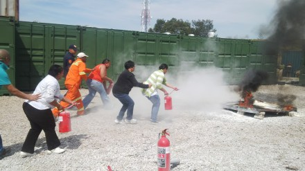 During the physical part of the training, Fire Wardens (in front) train with the extinguishers while the Fire-watchers (at the back), made sure everything was under control.   FLTR: Natasha Buis (front) and Edward Hatches (back), Fredine May (front) and Crystal Spies (back), Marchelle Arends (front) and Romeo Booysen.