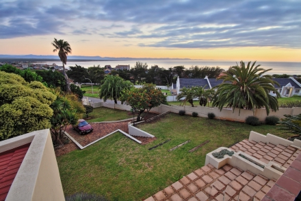 With four bedrooms (three en suite) and 4.5 bathrooms, this multi-storey, family home in Wavecrest in Jeffreys Bay has unobstructed sea views over Surf Point, Supertubes, the bay and mountains. Also included is a heated pool in the courtyard with additional built-in braai. The property is priced at R4.795 million through Pam Golding Properties.