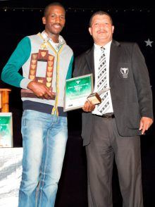 Siya Nkosana (right), Elite Coach for the SWD Cricket Black African Development program, received the award as Top Achiever in the category Development School of the Year at the Annual Eden Sport Awards from Mr Patrick Witbooi (Schools Sport Executive Member of the Eden Sport Council)