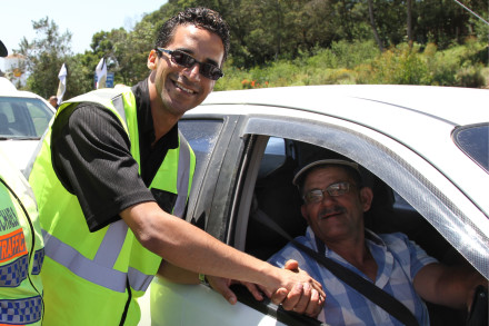 Eden Portfolio Chairperson for Corporate Services, Cllr Tertuis Simmers (middle) welcomes Mr Joppie Wilskut at the Bitou roadblock.