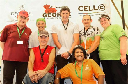 42km Hand Cycle Male Open. Back from left: Willie van der Westhuizen (sponsor), Daniel Maritz (Deputy Mayor), Ernst van Dyk (1st), Andries Scheepers (2nd) and Ansie Swart (OCC Operational Manager) Organiser). Front from left: Stuart McCreadie (3rd) and Brenda Vorster (George Airport Manager).