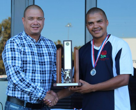 Arthur Lottering, captain of Ramblers, receive the trophy as Runners-Up of the Promotion League from Rudy Claassen (President of SWD Cricket).