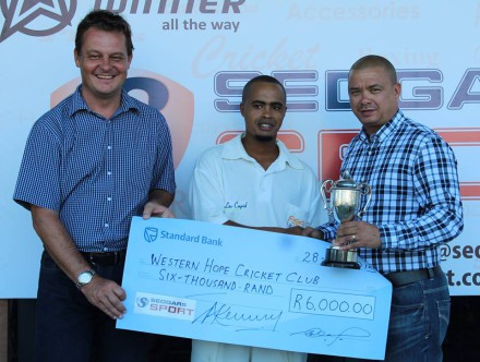 Donovan Gelant, captain of Western Hope, receive the trophy as winners of the Promotion League from Rudy Claassen (President of SWD Cricket). On the right is Albertus Kennedy (Chief Executive Officer)