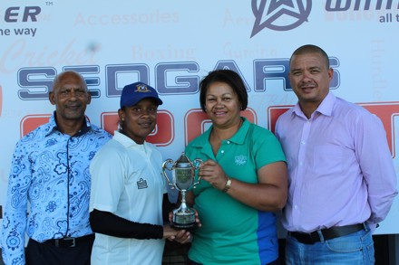 Haroldine Rhodes, (2nd from left) the captain of Union Stars, receives the trophy as winners of the SWD Women's League from Shireen Noble, Chairperson of SWD Women's Cricket Committee.  On the left is Mr John Stoffels (Speaker of the Oudtshoorn Municipal Council) and on the right is Rudy Claassen, President of SWD Cricket.