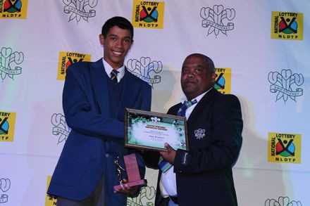 1.Jean Bruiners (left) excelled in the SWD U/15 Super League competition as the top run scorer and most successful bowler.  He received the trophy from Mr Lluwellyn Louw, Member of the Board of Directors of SWD Cricket.