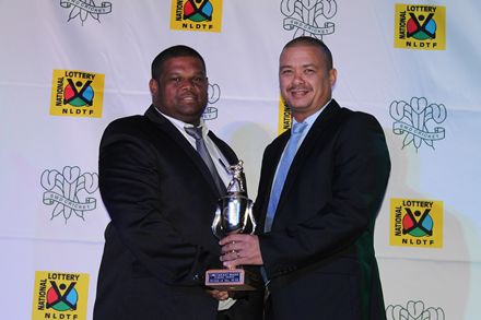 13.Mr André Du Plessis (left), the SWD Academy coach, received the trophy for SWD Representative Team of the Year from Mr Rudy Claassen, President SWD Cricket.
