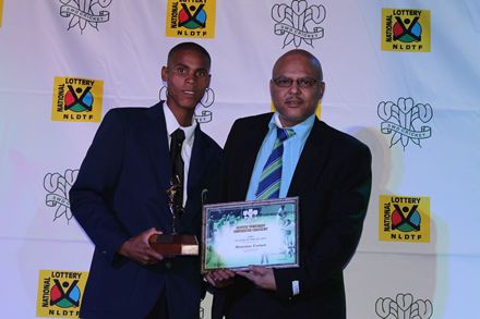 14.MonrianoFortuin, (left) received the award for LSEN Cricketer of the Season from Mr Calvin Scheepers, member of the Board of Directors of SWD Cricket