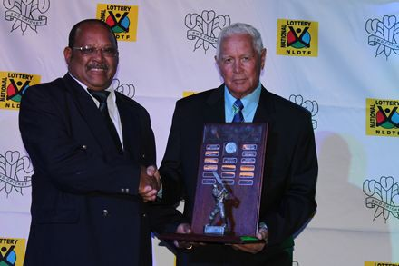 2.Mr Moses Carolus (left) received the trophy from Mr Simon Swigelaar, Honorary Life-President of the SWD Cricket Board for the outstanding achievements of Union Stars Cricket Club.