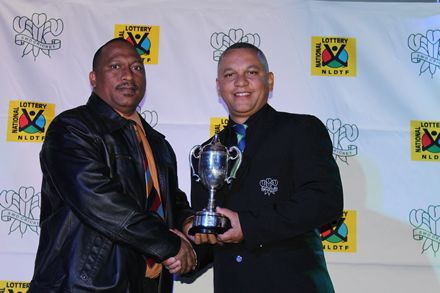 5.Mr James Du Preez (left) received the trophy for winners of the Promotion League on behalf of Western Hope Cricket Club from Mr Ricky Bell, member of the Board of Directors,  SWD Cricket