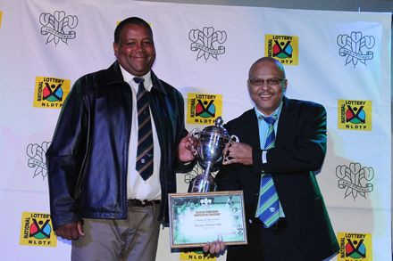7.George Nieuweveldt, (left) received the award for Umpire of the Season from Mr Calvin Scheepers, member of the Board of Directors of SWD Cricket