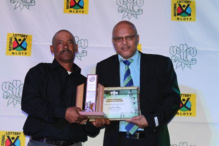 8.Mr JaftaJulies, (left) received the award for Groundsman of the Season from Mr Calvin Scheepers, member of the Board of Directors of SWD Cricket.