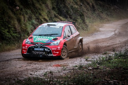 Leeroy Poulter and Elvene Coetzee: wet and muddy in their Toyota Yaris.