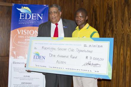 Mayor Van der Westhuizen hands over the cheque to Mr G Majolla from Moonlight Soccer Club.