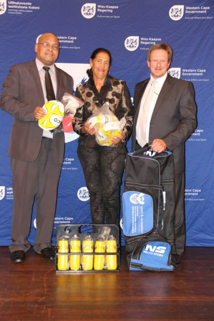 Minister Theuns Botha and the Executive Mayor of George Charles Stander hand over equipment to Valerie Goliath of Central Karoo Netball