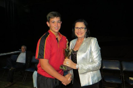 Cllr Aletti van Zyl hands a trophy to Jannie Claassens for u/14 rugby. He is from Volkskool in Potchefstroom.