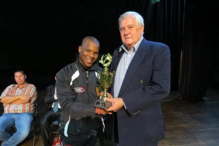 Cllr Rassie de Villiers, Portfolio Councillor for Sport, hands Qhama Masiza a trophy for u/19 rugby. He is from Louis Botha Technical High School in Bloemfontein.