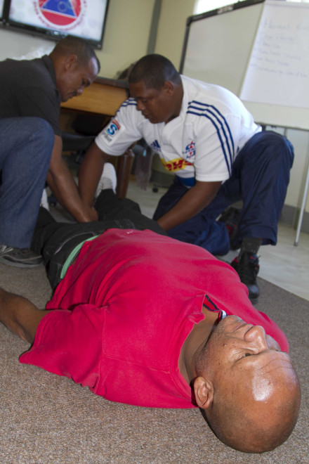 Mr Wayne Cronje poses as a fatality victim as trainees assess his injuries