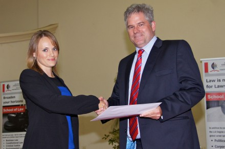 Howard Stephenson, a Director in Garlicke & Bousfield's Commercial Department, congratulates Pascale Coetzee, UKZN student, on her Garlicke &Bousfield Top Environmental Law Student Award for 2014.